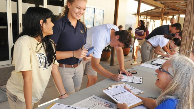 Nadia Kumar-Agarwal, Julie Spicer and Brandon Schwab registered to vote at Holy Trinity Episcopal Academy in 2016 during the League of Women Voters' campaign to register voters and future voters at Brevard schools.