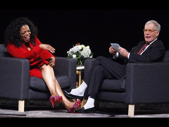 David Letterman and Oprah Winfrey laugh during A Conversations