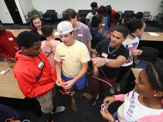 Leon County School students discuss sculptures they