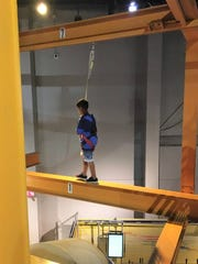 A Westfield 3rd grader wears a safety harness as he