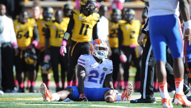 Florida Gators running back Kelvin Taylor (21) reacts after dropping a pass during the second half of the game against the Missouri Tigers at Faurot Field.