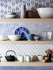 Since the floating shelves hide the wallpaper edges,