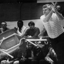 Bob Knight throws a chair across the court during an IU-Purdue game in February of 1985.