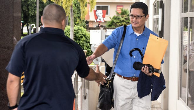 In this Sept. 2017 file photo, Glenn Wong is greeted upon his arrival to the District Court of Guam building in Hagåtña. Wong is appealing a decision that denied his motion to dismiss his indictment in the U.S. Court of Appeals for the Ninth Circuit.