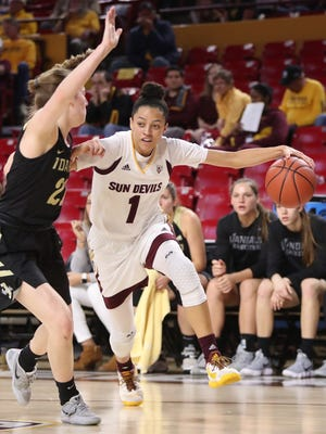 ASU's Reili Richardson (1) drives the lane against Idaho's Mikayla Ferenz (21) during the first half at Wells Fargo Arena on December 18, 2017 in Tempe, Ariz.