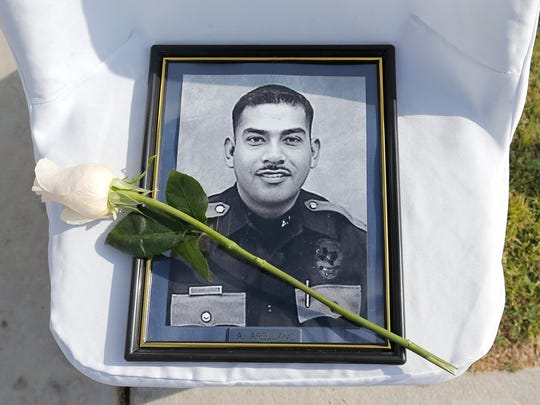 Photos of fallen officers, including Adrian Arellano, lined the path leading to the police memorial at Chuck Heinrich Park in El Paso during a ceremony in 2015.