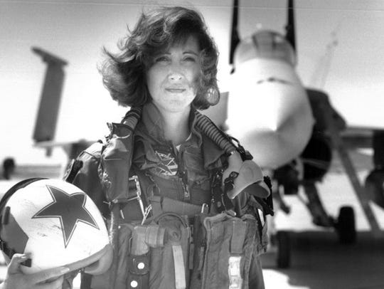 Lt. Tammie Jo Shults, one of the first women to fly Navy tactical aircraft, poses in 1992 in front of an F/A-18A with Tactical Electronics Warfare Squadron VAQ 34. After leaving active duty in early 1993, Shults was the pilot of the Southwest plane that made an emergency landing on April 17, 2018, after an engine explosion.