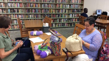 Charity knitting is even better when we do it together