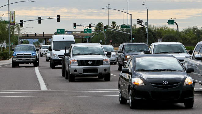 Northern Avenue traffic west bound at 99th Avenue in Peoria. Better roads, freeways and growth of cities are helping shorten work commutes for some West Valley residents.