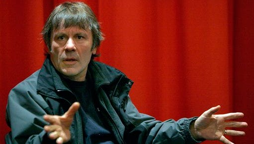 """In this file photo, Iron Maiden singer Bruce Dickinson gestures after the screening of his film """"Chemical Wedding"""", with a screenplay by Dickinson, as he promotes the movie DVD, in Paris. Iron Maiden says singer Bruce Dickinson has been treated for cancer of the tongue, but hopes to be back to full fitness soon. A statement posted Thursday on the band's official website says a cancerous tumor was discovered during a check-up in December, and Dickinson has completed a seven-week course of chemotherapy and radiotherapy. It says the prognosis is """"extremely good,"""" and doctors expect Dickinson to make a full recovery, """"with the all-clear envisaged by late May."""""""