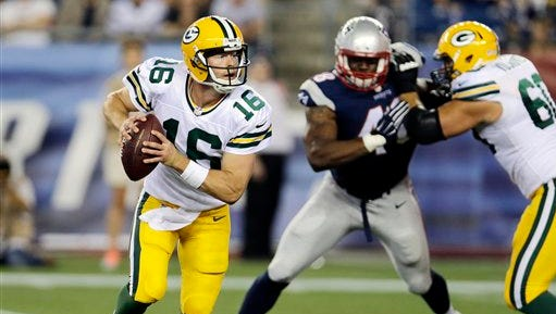 Green Bay Packers quarterback Scott Tolzien rolls out against the New England Patriots in the second half of an NFL preseason football game Thursday, Aug. 13, 2015, in Foxborough, Mass. (AP Photo/Charles Krupa)