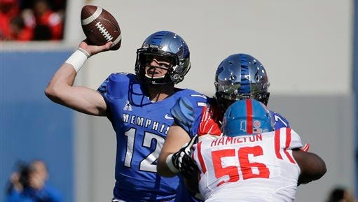 Memphis quarterback Paxton Lynch (12) passes as Mississippi defensive tackle Woodrow Hamilton (56) rushes in the first half of an NCAA college football game Saturday, Oct. 17, 2015, in Memphis, Tenn. (AP Photo/Mark Humphrey)