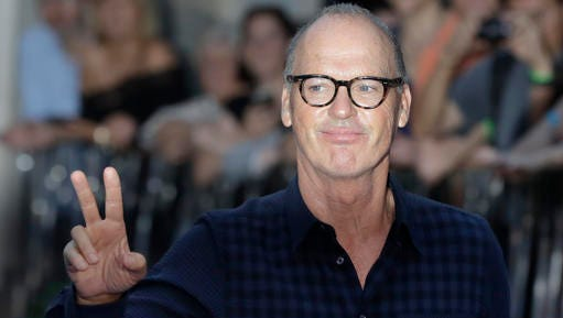 """FILE - In this Sept. 15, 2016, file photo, actor Michael Keaton poses for photographers upon arrival at the world premiere of the film 'The Beatles, Eight Days a Week' in London. Marvel Studios president Kevin Feige confirmed in an interview with the Toronto Sun published on Nov. 2, 2016, that Keaton will play the villain Vulture in """"Spider-man: Homecoming."""""""