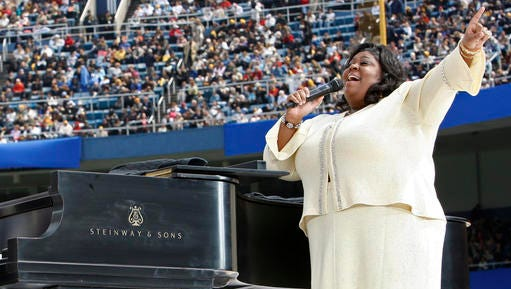 "FILE - In this Sunday, April 20, 2008 file photo, Kim Burrell performs prior to a Mass by Pope Benedict XVI at Yankee Stadium in New York. Ahead of a performance on the talk show ""Ellen"" in early January 2017, gospel singer Burrell says she make ""no excuses or apologies"" for a sermon at a Houston church where she referred to gays and lesbians as perverted."