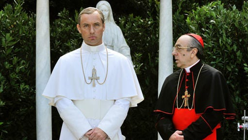 """This image released by HBO shows Jude Law, left, and Silvio Orlando from the HBO series, """"The Young Pope,"""" premiering Sunday at 9 p.m. EST."""