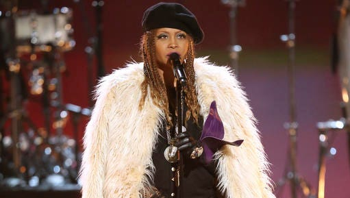 "FILE - This June 26, 2016 file photo shows Erykah Badu performing ""The Ballad of Dorothy Parker"" during a tribute to Prince at the BET Awards in Los Angeles."