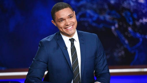 """FILE - In this Sept. 29, 2015, file photo, Trevor Noah appears during a taping of """"The Daily Show,"""" on Comedy Central, in New York. """"The Daily Show"""" with Noah canceled its episode on Tuesday, March 14, 2017, because of the winter storm. The network is airing a rerun instead."""