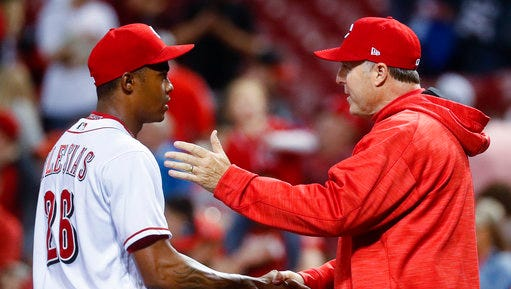 Cincinnati Reds manager Bryan Price, right, congratulates relief pitcher Raisel Iglesias after the team's baseball game against the Philadelphia Phillies, Wednesday, April 5, 2017, in Cincinnati. The Reds won 2-0. (AP Photo/John Minchillo)