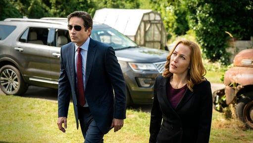 """This photo provided by FOX shows, David Duchovny, left, as Fox Mulder and Gillian Anderson as Dana Scully in an episode of """"The X-Files."""" Fox said Thursday it has ordered a second chapter of what it's calling an """"X-Files"""" """"event series."""" The 10-episode series will air during the upcoming 2017-18 TV season."""