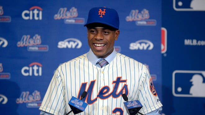 Curtis Granderson answers a question during a news conference announcing his signing.