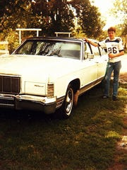 "A teenage Kyle Munson poses with his first car, a 1976 Lincoln Continental Town Car nicknamed ""Jaws"" with more than 200,000 miles that he purchased for $1 from his uncle."