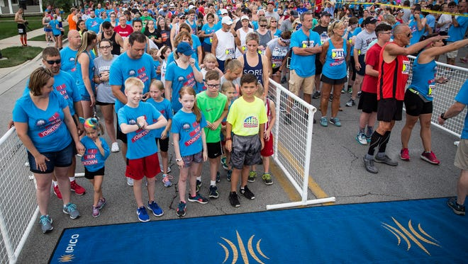 Runners hit the streets of Yorktown on July 4 during the eighth annual Four for the Fourth race. This year the race saw over 1,100 racers participate.