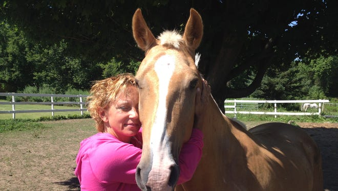 Lisa Anne Kreger with her horse Dusty.