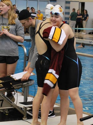 Farmington Hills Mercy's Kylie Goit is congratulated by Annette Dombkowski after completing the 200 freestyle relay.