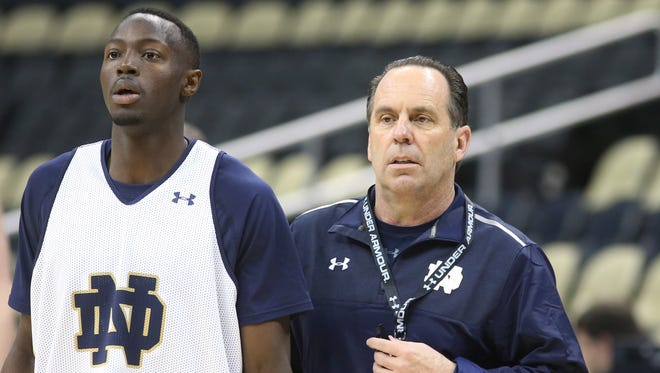 Notre Dame Fighting Irish guard Jerian Grant (22) and Fighting Irish head coach Mike Brey (R) look on during practice before the second round of the 2015 NCAA tournament at Consol Energy Center.