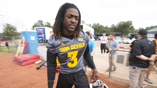 ASU quarterback Bryce Perkins takes the field at the start of practice during ASU football camp practice at Rumsey Park in Payson on Wednesday, August 3, 2016.