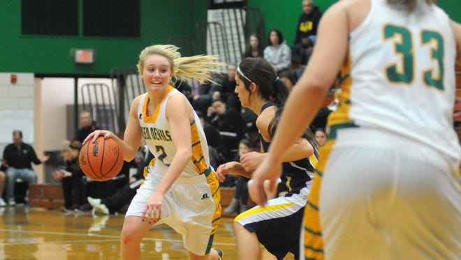 Green Devils' Skye Willer tries to drive towards the basket Monday, Dec 29,  during a semifinal game of the Harry C. Moore Classic basketball tournament.