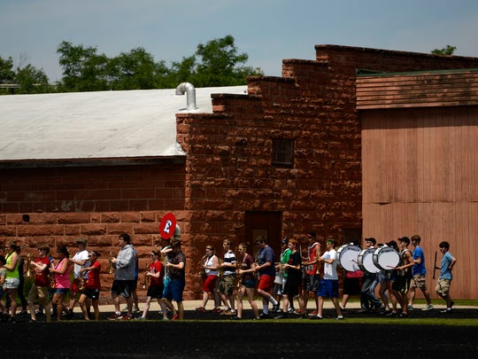 Members of the Green Bay East High School marching band practice at the school in Green Bay on Thursday. The band is preparing to play in the National Independence Day Parade on July 4th in Washington D.C.