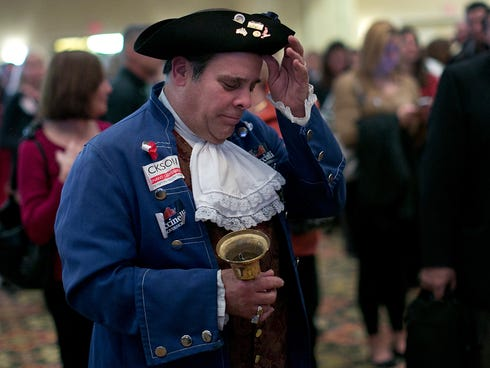 Tea Party member John Wallmeyer watches results from the Virginia Governor's race at an election night gathering of supporters of Republican candidate Virginia Attorney General Ken Cuccinell  Tuesday in Richmond, Virginia. 2