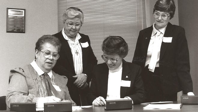 Sister Agnes Marie Henkel and Sister Michaela Crowley, both of the School Sisters of St. Francis, and Sister Mary Mollison and Sister Jean Steffes, both of the Congregation of Sisters of St. Agnes, are shown back in 1987 signing documents to transfer the sponsorship of Waupun Memorial Hospital (a member of Agnesian HealthCare) from the School Sisters of St. Francis, Milwaukee, to the Congregation of Sisters of St. Agnes.