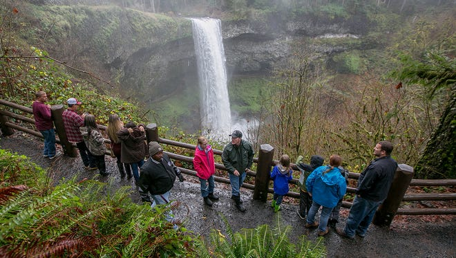 "Viistors hike the South Falls trail on ""Green Friday"" Nov. 25, 2016, at Silver Falls State Park. Oregon's state parks, including Silver Falls, were free on Black Friday as a way to encourage people to get outdoors instead of spending the day shopping."