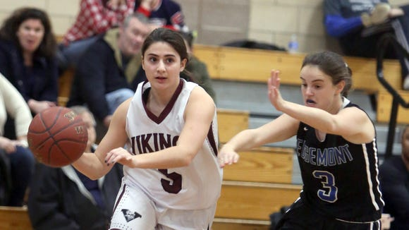 Sofia Mazza of Valhalla drives on Edgemont's Rachel Weisglass during the 8th annual Autism Classic girls basketball tournament at Irvington High School Jan. 14, 2017. Valhalla defeated Edgemont 55-42.