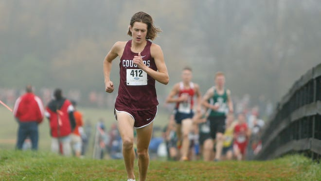 Holy Cross High School's Keeton Thornsberry leads during the KHSAA Class A cross country state championship at Kentucky Horse Park on Saturday, Nov. 4, 2017 in Lexington, Ky.