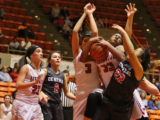 Lexington's Kyla Taylor gets fouled while going up for a shot against Obion County.