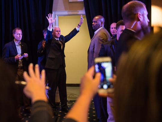 Vice Presidential nominee and Indiana Gov. Mike Pence waves  to a crowd on Thursday Oct. 6, 2016 after a town hall at the Gettysburg Wyndham Hotel.