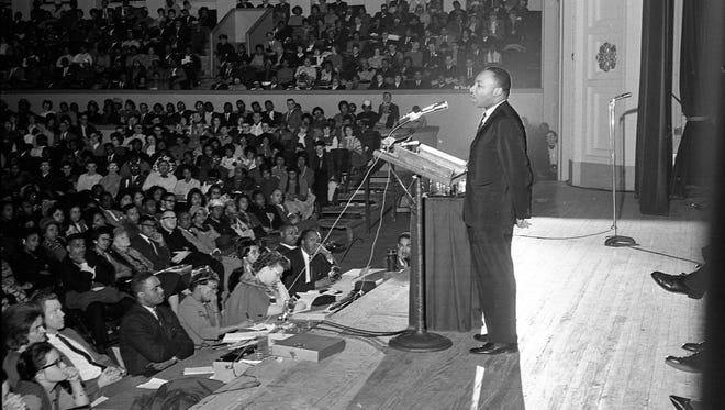"""Dr. Martin Luther King Jr. speaks at the Milwaukee Auditorium (now Milwaukee Theatre). This photo ran in the Jan. 28, 1964, edition of the Milwaukee Journal. King told the audience: """"You discover that there are things a man will die for, and if a man hasn't found a thing he'll die for, then he is not fit to live."""""""