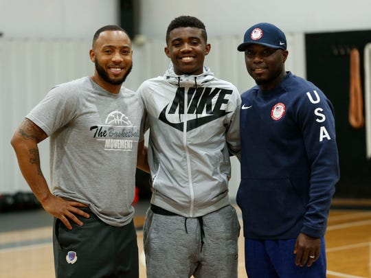 Anton Brookshire, center, is pictured here with his two uncles, Sylvester Yanders, left, and Rob Yanders, right, at The Basketball Movement training facility in Nixa on January 22, 2018