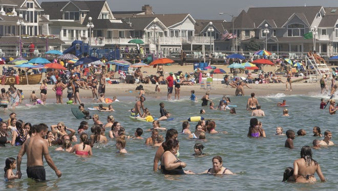 Swimmers at the beach in Avon.