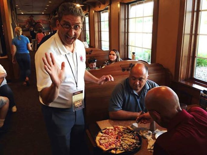 Acts 1:8 Ministry founder and president, Jeff Van Beaver, serves pizza at Pizza Ranch in Green Bay.
