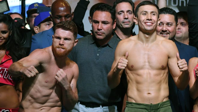 Canelo Alvarez, left, and Gennady Golovkin pose after their weigh-in Friday.
