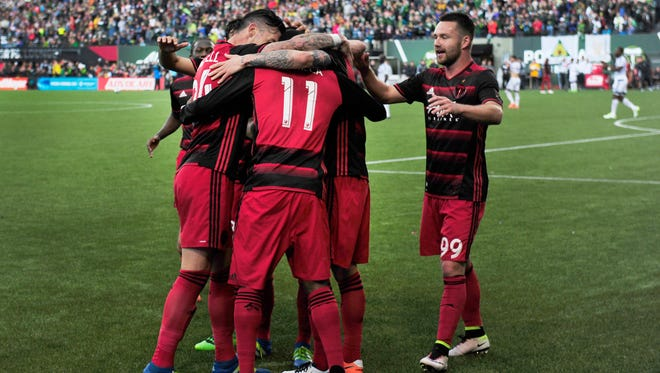 Portland Timbers forward Dairon Asprilla (11) celebrates with teammates after scoring during the second half of an MLS soccer game against the Vancouver Whitecaps in Portland, Ore., on Sunday, May 22, 2016. (AP Photo/Steve Dykes)