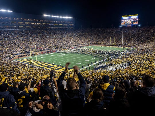 Fans cheer at Michigan Stadium for Michigan's game against Wisconsin in 2018.