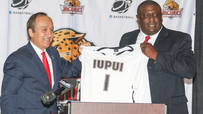 IUPUI Chancellor Nasser H. Paydar (left) introduced the school's new director of athletics, Roderick Perry, Tuesday.