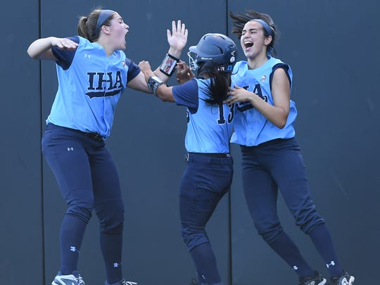 High school softball state Tournament of Champions final between Immaculate Heart Academy and Immaculate Conception at  Seton Hall University in South Orange on Friday, June 9 2017. (Center) IHA #13 Reese Guevarra celebrates with teammates after scoring a run.