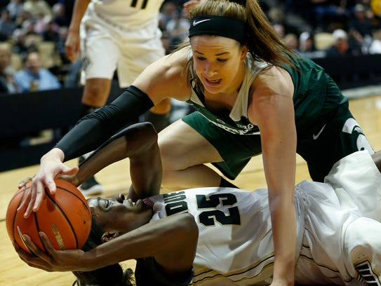 Tamara Farquhar of Purdue tries to keep the ball from