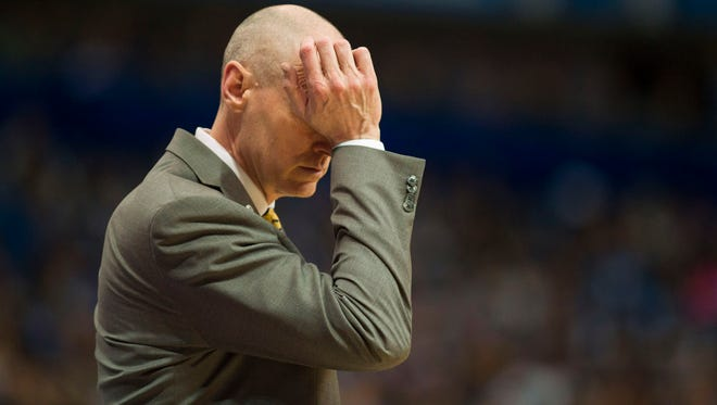 Dallas Mavericks head coach Rick Carlisle rubs his eye during the second quarter against the Oklahoma City Thunder in game three of the first round of the NBA Playoffs at American Airlines Center.